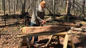 Tom Locatell hews a fallen tree