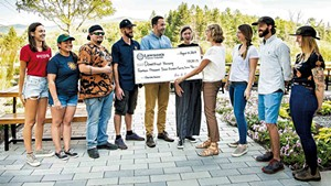 Karen Lawson presenting a check to Downstreet Housing in 2019