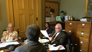 Sen. Dick Sears (D-Bennington) and Sen. Peg Flory (R-Rutland) negotiate with Rep. Chip Conquest (D-Newbury), with his back to the camera, on driver's license-suspension legislation.