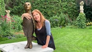 Leslie Fry in her sculpture garden in Winooski