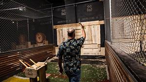 Rick Chaput tossing an axe at Burly Axe Throwing