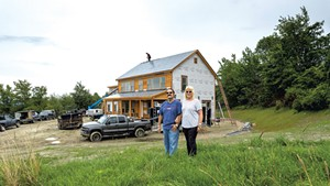 Phil and Debbie Gianelli in front of their Hinesburg home build
