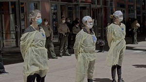 VIRAL DOUBTS Health care workers face anti-lockdown protesters in Wang's documentary about the pandemic in China and the U.S.