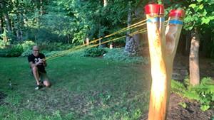 Troy Headrick shoots his giant slingshot