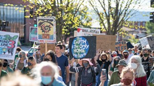 Demonstrators on Burlington's Main Street in the Stop Line 3 March and Rally