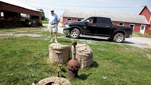 John Belter by the contaminated well on his South Burlington farm in 2019