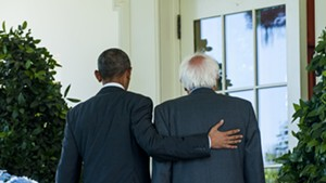 President Barack Obama and Sen. Bernie Sanders walk past the Rose Garden Thursday on their way to an Oval Office meeting.
