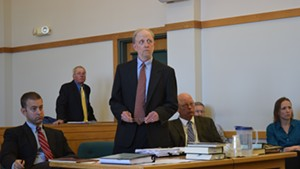Defense attorneys David Williams (standing) and Brooks McArthur (left) argue motions Tuesday for Sen. Norm McAllister (right), a day before his sexual assault trial begins.