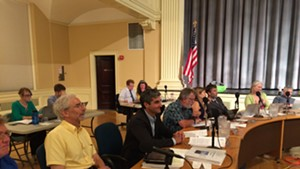 Chief administrative officer Bob Rusten, far left, sits next to Mayor Miro Weinberger at Monday's council meeting.