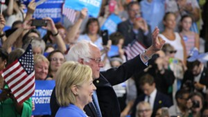 Hillary Clinton and Bernie Sanders campaign together Tuesday morning in Portsmouth, N.H.