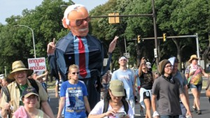 Los Angeles artist Alex Schaefer marched inside his 10-foot-tall Big Bernie creation.