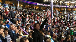 Vermont delegate Ashley Andreas protests as Sen. Bernie Sanders addresses the Democratic National Convention Monday in Philadelphia