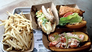 French fries, the Vietnamese sausage, fried chicken sandwich and lobster roll at Honeypie