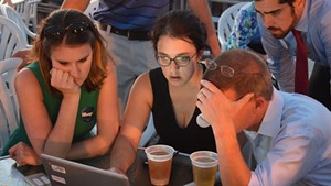 House Speaker Shap Smith reviews election results last Tuesday at Breakwater Café & Grill with campaign manager Erika Wolffing (left) and supporter Candace Morgan.