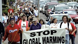 Protesters participating in a walk along Route 7 in South Burlington, September 4, 2006