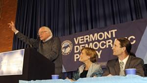 Sen. Bernie Sanders (I-Vt.), left, rallies a crowd Friday night in Montpelier for Democratic gubernatorial candidate Sue Minter and David Zuckerman, Progressive/Democratic candidate for lieutenant governor.