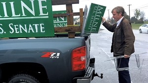 Scott Milne unloading campaign signs at a  diner in Pittsford