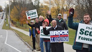 Phil Scott, Randy Brock and supporters on Saturday on North Avenue in Burlington