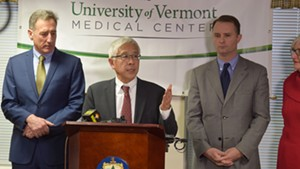 Dr. Harry Chen (center) at a 2015 press conference.