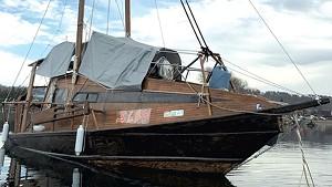 The boat Sled moored in Burlington Harbor.