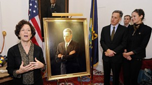 Artist August Burns speaks at the unveiling of Peter Shumlin's official portrait.