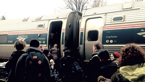 Passengers boarding the Amtrak Vermonter in Essex Junction