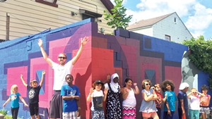 Sloan Collins and his helpers in front of a mural supported by the BCA Community Fund