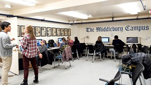 Student journalists working on an issue of the Campus