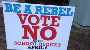 Sign encouraging voters to defeat budget