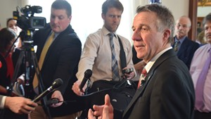 Gov. Phil Scott discusses health care negotiations with reporters Friday in his Statehouse office.