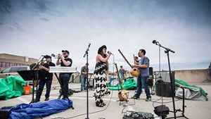 Barika with Kat Wright on the Lakeview Garage roof