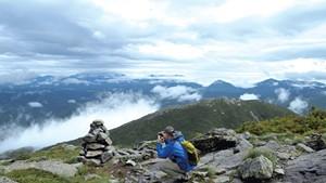Steve Humphry taking a photo on Algonquin Peak
