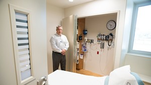 Emergency Department director Tom Rounds in a room outfitted for mental health patients at Rutland Regional Medical Center