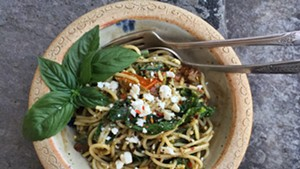 Pasta tossed with wilted kale, tomatoes, feta and pesto.