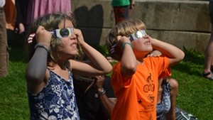 Kids take in the solar eclipse at the Fletcher Free Library in Burlington