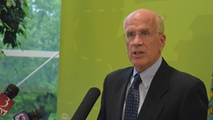 Congressman Peter Welch (D-Vt.) speaks to the media Tuesday at Burlington International Airport.