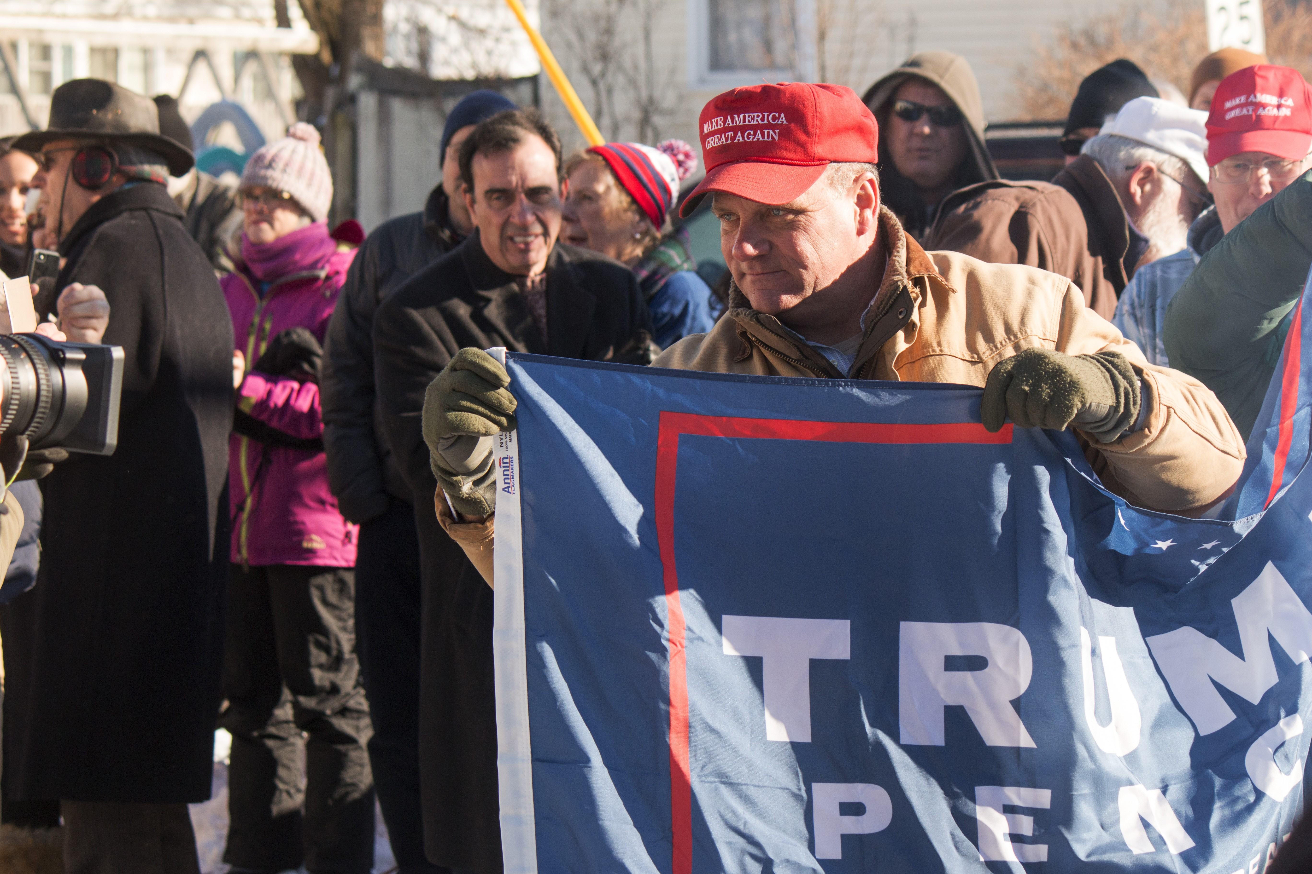 Raising Untrump >> Bagpipes Speeches And Drive By Protesters Mark The Raising Of New