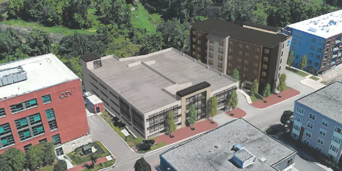 A rendering showing the proposed parking garage and hotel next to the existing Community College of Vermont building - CITY OF WINOOSKI