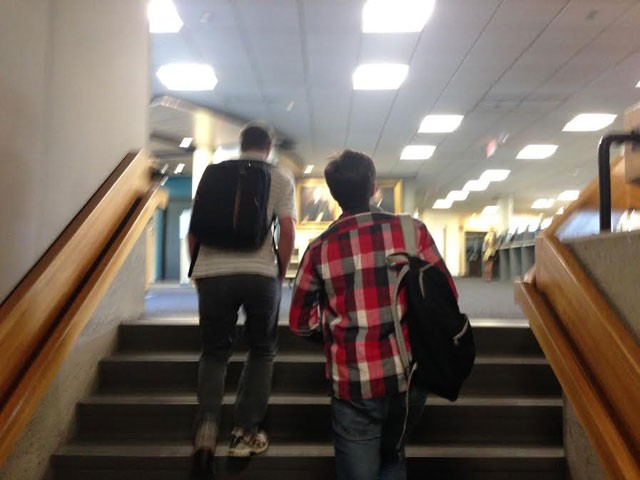 The two mystery men pictured leaving Bailey/Howe Library last Thursday afternoon - PAUL HEINTZ