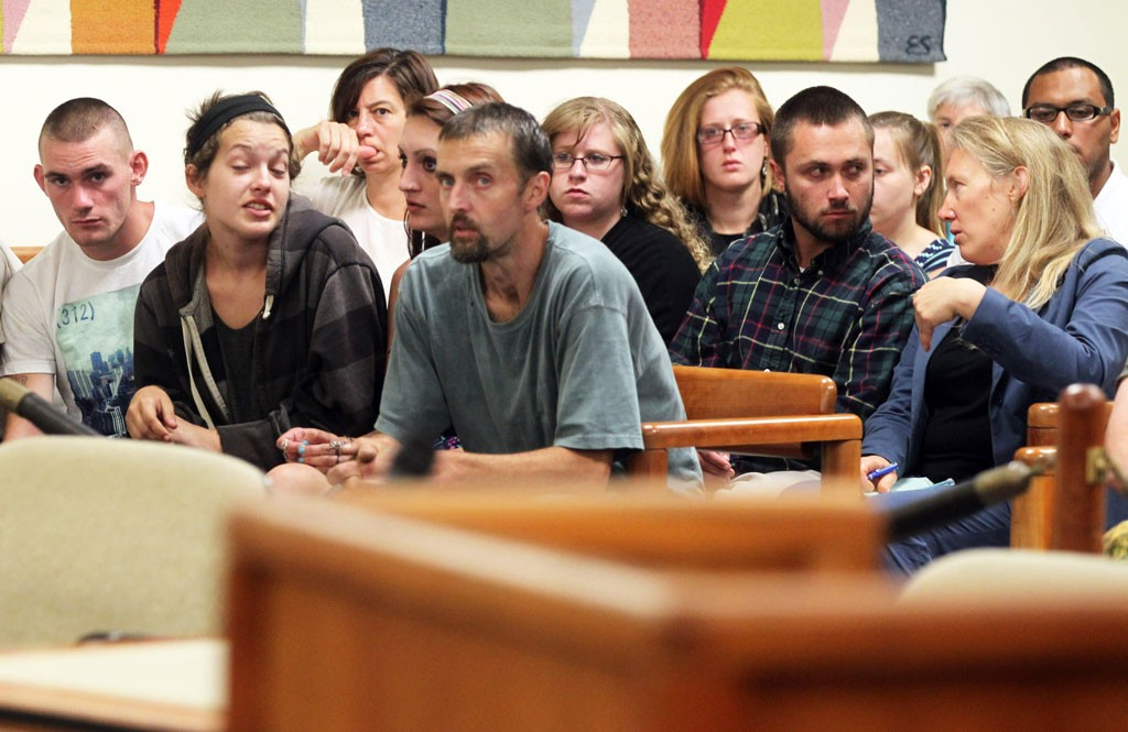 Desiree Herring and Felicia Kennison, center of front row, at their mother's arraignment Monday - TOBY TALBOT/ASSOCIATED PRESS