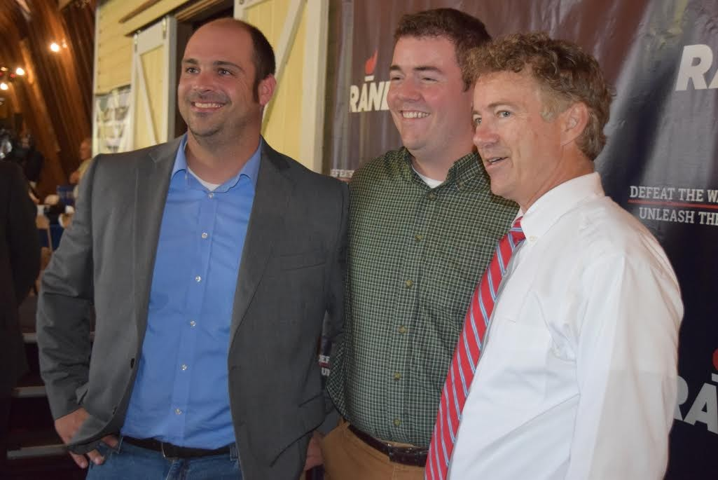 Sen. Rand Paul (R-Ky.), right, poses for a photo with state Sen. Dustin Degree (R-Franklin), left, and Rep. Corey Parent (R-St. Albans). - TERRI HALLENBECK