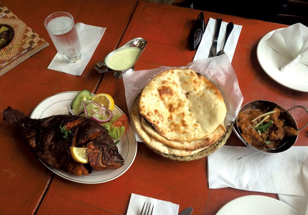 Whole fish, naan and lamb curry at 786 Halal - ALICE LEVITT