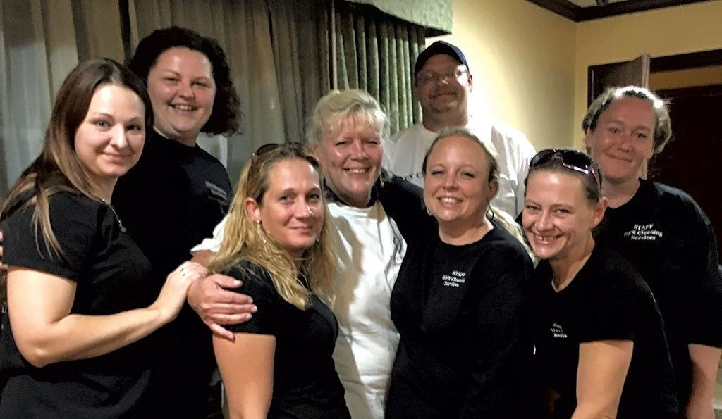 Tara Cullinan (third from right) and her staff.