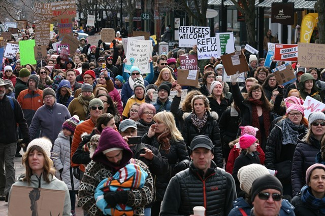 Marchers in Burlington during a pro-refugee rally - JOHN JAMES