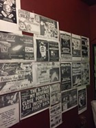 An archive of past flyers hang on the walls of 242 for its farewell show.