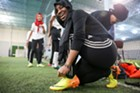 Fama Haji lacing up her boots