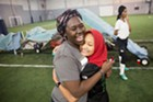 Sami Lar (in red scarf) and Sumeya Musa celebrating a goal