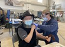 Stuck in Vermont: The Tran Family Patriarch Gets Vaccinated