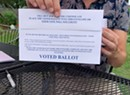Scott Signs Universal Mail-In Voting Bill, Urges Legislature to Expand It