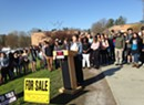 Burlington High School Students Protest Cuts With 'For Sale' Signs